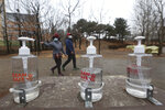 Bottles of hand sanitizer are displayed for use at a park in Goyang, South Korea, Friday, Jan. 22, 2021. South Korea is reporting its smallest daily increase in coronavirus infections in two months as officials express cautious hope that the country is beginning to wiggle out from its worst wave of the pandemic. (AP Photo/Ahn Young-joon)