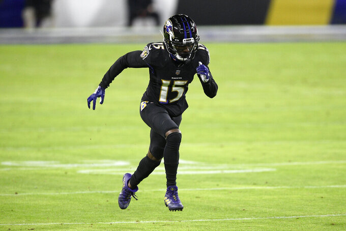 Baltimore Ravens wide receiver Marquise Brown runs a route against the Dallas Cowboys during the first half of an NFL football game, Tuesday, Dec. 8, 2020, in Baltimore. (AP Photo/Nick Wass)