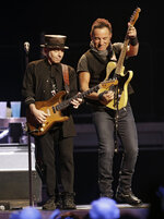 FILE - Bruce Springsteen, right, performs with Nils Lofgren of The E Street Band in Cleveland on Feb. 23, 2016. Springsteen's latest album,