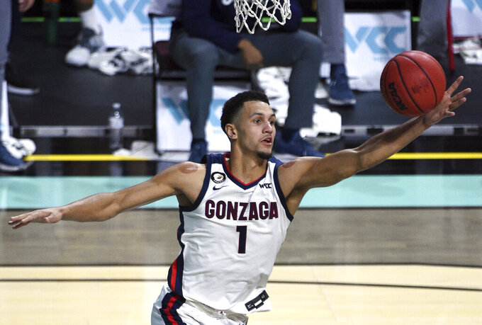 Gonzaga guard Jalen Suggs grabs a rebound against Saint Mary's during the second half of an NCAA semifinal college basketball game at the West Coast Conference tournament Monday, March 8, 2021, in Las Vegas. (AP Photo/David Becker)
