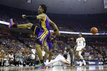 LSU forward Trendon Watford (2) celebrates after he scored over Texas guard Courtney Ramey (3) during the first half of an NCAA college basketball game, Saturday, Jan. 25, 2020, in Austin, Texas. (AP Photo/Eric Gay)