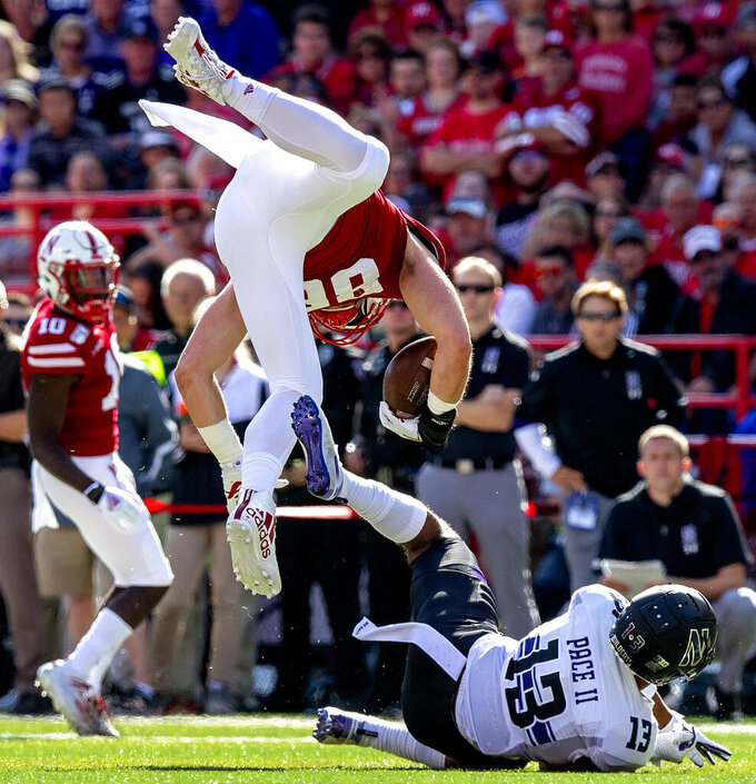 Nebraska tight end Jack Stoll (86) gets flipped on a hit by Northwestern JR Pace (13) during the first half of an NCAA college football game, Saturday, Oct. 5, 2019 in Lincoln, Neb. (Francis Gardler/Lincoln Journal Star via AP)