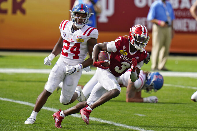 Indiana wide receiver Ty Fryfogle (3) runs past Mississippi defensive back Deane Leonard during the first half of the Outback Bowl NCAA college football game Saturday, Jan. 2, 2021, in Tampa, Fla. (AP Photo/Chris O'Meara)