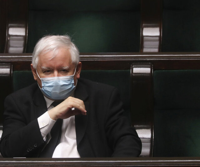 Leader of Poland's ruling Law and Justice party, Jaroslaw Kaczynski, wearing a face mask to protect against the coronavirus, sits in parliament in Warsaw, Poland, on Wednesday, May 6, 2020, ahead of the debate on the postal presidential election that is scheduled for Sunday The ruling party wants the election in May, the Senate is calling for a state of natural disaster that would allow for postponement by three months. (AP Photo/Czarek Sokolowski)