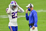 Buffalo Bills head coach Sean McDermott speaks with strong safety Micah Hyde (23) during the first half of an NFL football game, Sunday, Oct. 4, 2020, in Las Vegas. (AP Photo/David Becker)