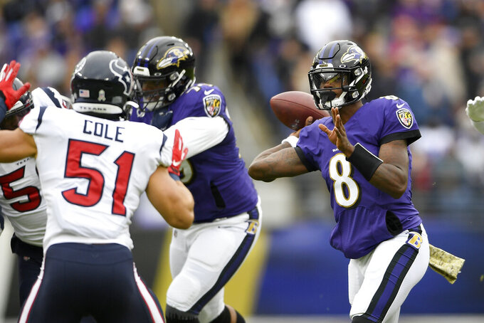 Baltimore Ravens quarterback Lamar Jackson (8) throws a pass against the Houston Texans during the first half of an NFL football game, Sunday, Nov. 17, 2019, in Baltimore. (AP Photo/Nick Wass)