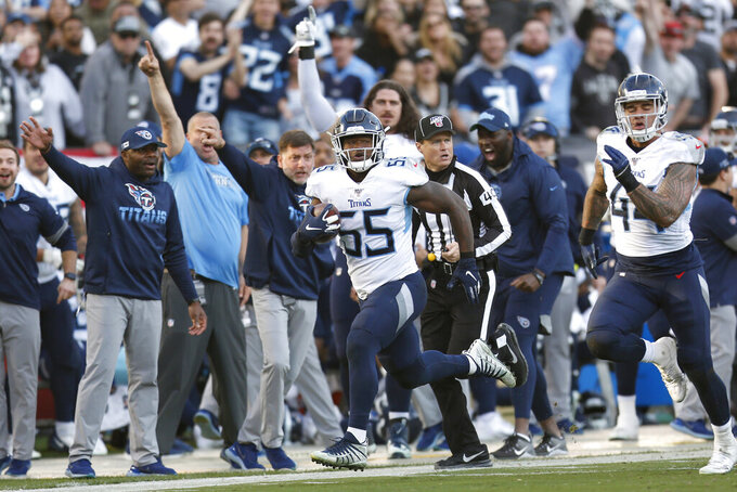 Tennessee Titans inside linebacker Jayon Brown (55) returns a fumble for a touchdown against the Oakland Raiders during the second half of an NFL football game in Oakland, Calif., Sunday, Dec. 8, 2019. (AP Photo/D. Ross Cameron)