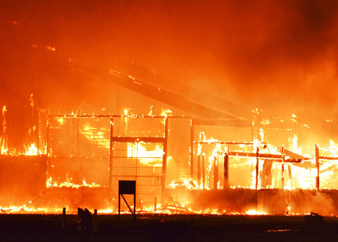The Cooperative Producers Inc. dry fertilizer plant near U.S. Hwy 6 and Showboat Blvd. in Hastings, Neb., burns Thursday, May 23, 2019,. Hastings Fire and Rescue responded about 11:30 p.m. and called for mutual aid from neighboring fire departments. No injuries were reported and the extent of damages to the plant weren't clear. (Will Vraspir/The Hastings Tribune via AP)