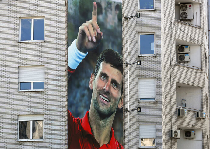 A billboard depicting Serbian tennis player Novak Djokovic is seen on a building in Belgrade, Serbia, Wednesday, June 24, 2020. Djokovic has tested positive for the coronavirus after taking part in a tennis exhibition series he organized in Serbia and Croatia. The top-ranked Serb is the fourth player to test positive for the virus after first playing in Belgrade and then again last weekend in Zadar, Croatia.(AP Photo/Darko Vojinovic)