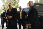 US Secretary of State Mike Pompeo, left, arrives for a meeting with Ethiopian Prime Minister Abiy Ahmed at the Prime Minister's office in Addis Ababa, Tuesday Feb. 18, 2020. Pompeo's visit to Africa is the first by a Cabinet official in 18 months. (Andrew Caballero-Reynolds/Pool via AP)