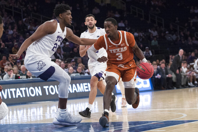 FILE - In this April 2, 2019, file photo, Texas guard Courtney Ramey (3) drives to the basket against TCU center Kevin Samuel (21) during the second half of a semifinal college basketball game in the National Invitational Tournament, at Madison Square Garden in New York. Texas' top three scorers and rebounders from last season are gone, but they return an experienced backcourt in point guard Matt Coleman and guards Jase Febres and Ramey. (AP Photo/Mary Altaffer, File)