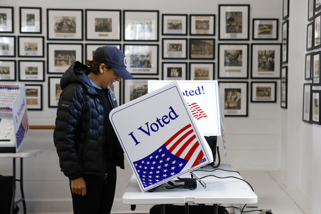 A voter fills out her ballot at a primary polling place, Saturday, Feb. 29, 2020, in Charleston, S.C. (AP Photo/Patrick Semansky)