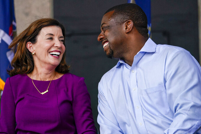 New York state Sen. Brian Benjamin, right, and Gov. Kathy Hochul smile together during an event in the Harlem neighborhood of New York, Thursday, Aug. 26, 2021, in New York. Hochul has selected Benjamin as her choice for lieutenant governor. (AP Photo/Mary Altaffer)