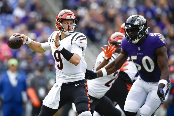 Cincinnati Bengals quarterback Joe Burrow throws a pass against the Baltimore Ravens during the first half of an NFL football game, Sunday, Oct. 24, 2021, in Baltimore. (AP Photo/Gail Burton)