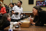 Maria Isabel Bueso, 24, of Concord, Calif., left, shakes hands with Rep. Alexandria Ocasio-Cortez, D-N.Y., after Bueso, who has a rare disease and needs life saving treatments that are unavailable in her home country of Guatemala, testified at a House Oversight subcommittee hearing into the Trump administration's decision to stop considering requests from immigrants seeking to remain in the country for medical treatment and other hardships, Wednesday, Sept. 11, 2019, in Washington. Behind Bueso is Jonathan Sanchez, 16, of Boston, who has cystic fibrosis and was also on the panel. (AP Photo/Jacquelyn Martin)