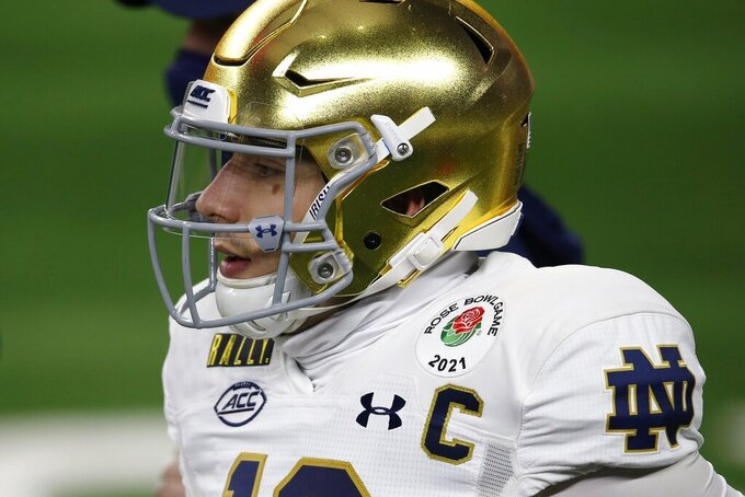Notre Dame quarterback Ian Book (12) warms up before their Rose Bowl NCAA college football game against Alabama in Arlington, Texas, Friday, Jan. 1, 2021. (AP Photo/Roger Steinman)