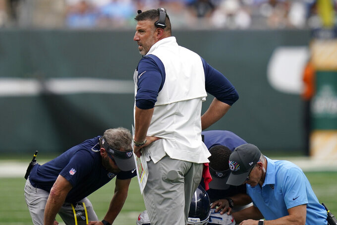 Tennessee Titans head coach Mike Vrabel stands on the field during a medical break during the second half of an NFL football game against the New York Jets, Sunday, Oct. 3, 2021, in East Rutherford, N.J. (AP Photo/Seth Wenig)
