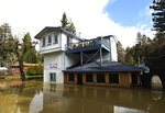 Floodwaters surround a building in Guerneville, Calif., on Friday, Feb. 15, 2019. Streets and low-lying areas were affected as the Russian River swelled above it's banks. (AP Photo/Josh Edelson)