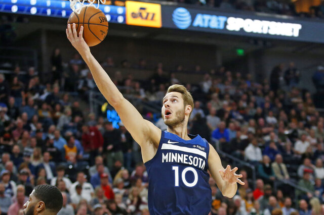 FILE - In this Nov. 18, 2019, file photo, Minnesota Timberwolves forward Jake Layman (10) lays up the ball in the first half during an NBA basketball game against the Utah Jazz in Salt Lake City. Timberwolves forward Jake Layman has been cleared to return to practice with the team. His absence at 39 straight games and counting because of a sprained left toe. Layman will be re-evaluated in one week before his status is reassessed. That means he'll sit out at least four more games. (AP Photo/Rick Bowmer, File)