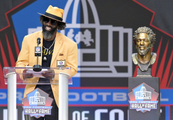 Former NFL player Ed Reed speaks during the induction ceremony at the Pro Football Hall of Fame, Saturday, Aug. 3, 2019, in Canton, Ohio. (AP Photo/David Richard)