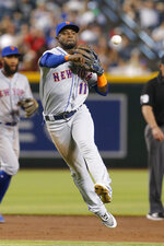 New York Mets shortstop Adeiny Hechavarria makes an off-balance throw for an out on a ball hit by Arizona Diamondbacks' Ketel Marte in the third inning during a baseball game, Sunday, June 2, 2019, in Phoenix. (AP Photo/Rick Scuteri)