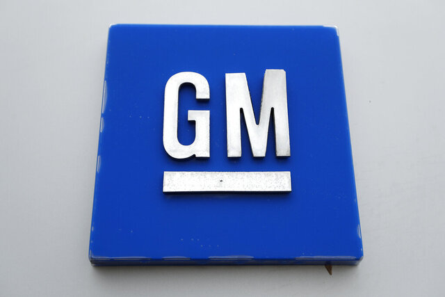 This Monday, Jan. 27, 2020, photo shows the General Motors logo. General Motors is expected to reveal that it will build the Cadillac Lyriq electric SUV at its factory in Spring Hill, Tenn., when it makes a major manufacturing announcement Tuesday, Oct. 20, 2020. (AP Photo/Paul Sancya)