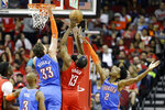 Houston Rockets guard James Harden (13) shoots as Oklahoma City Thunder forward Mike Muscala (33) and guard Shai Gilgeous-Alexander (2) defend during the first half of an NBA basketball game, Monday, Jan. 20, 2020, in Houston. (AP Photo/Eric Christian Smith)