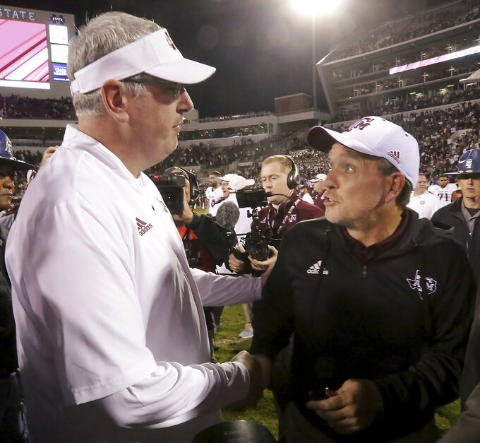 Texas A&M head coach Jimbo Fisher, right, congratulates Mississippi State head coach Joe Moorhead, left, after an NCAA college football game on Saturday, Oct. 27, 2018, in Starkville, Miss. (AP Photo/Jim Lytle)
