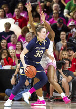 Notre Dame's Jessica Shepard (32) works in the post against North Carolina State's DD Rogers, right, during the first half of an NCAA college basketball game in Raleigh, N.C., Monday, Feb. 18, 2019. (AP Photo/Ben McKeown)