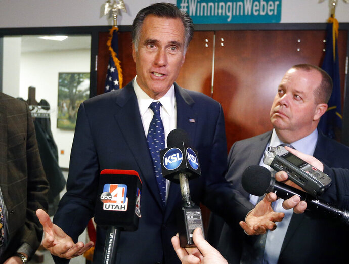 """FILE - In this Friday Jan., 18, 2019 file photo, Utah Sen. Mitt Romney, left, speaks with reporters after visiting with local officials to discuss how the four-week partial government shutdown is impacting an area with several major federal employers, including the Internal Revenue Service in Ogden, Utah. Sen. Mitt Romney says he's """"sickened"""" by the dishonesty the Russia investigation found in the Trump White House. Now President Donald Trump is firing back at the Utah Republican, tweeting Saturday, April 20, 2019 that if Romney """"spent the same energy fighting Barack Obama as he does fighting Donald Trump, he could have won the race (maybe)!"""" Romney has been one of the few prominent Republicans to criticize Trump since Trump's election. (AP Photo/Rick Bowmer, File)"""