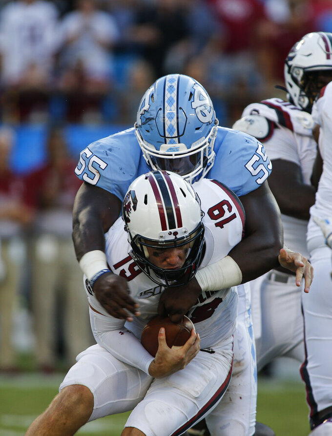 North Carolina defensive lineman Jason Strowbridge (55) sacks South Carolina quarterback Jake Bentley in the second half of an NCAA college football game in Charlotte, N.C., Saturday, Aug. 31, 2019. North Carolina won 24-20. (AP Photo/Nell Redmond)
