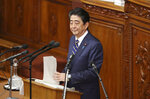 Japanese Prime Minister Shinzo Abe delivers his policy speech during a parliamentary session in Tokyo, Monday, Jan. 28, 2019. Abe pledged Monday he will further expand his country's already improving ties with China but said Japan still needs to bolster its defense capability as far as space amid concern about Chinese military activity and uncertainty over North Korea's denuclearization. (AP Photo/Koji Sasahara)
