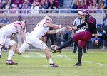 Boston College's Hunter Long blocks a punt but commits a roughing the kicker penalty against Florida State punter Logan Tyler in the first quarter of an NCAA college football game in Tallahassee, Fla., Saturday, Nov. 17, 2018. (AP Photo/Mark Wallheiser)