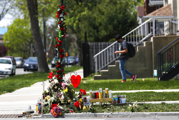 A memorial is set up near the site where 22-year-old Anthony Alvarez was shot several weeks ago during a foot pursuit by Chicago police in Chicago's Portage Park on Tuesday, April 27, 2021 in Chicago. Chicago's independent police review board has released video of the 22-year-old Latino man who was shot in the back late last month during a foot chase.   (Jose M. Osorio /Chicago Tribune via AP)