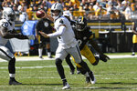 Las Vegas Raiders quarterback Derek Carr (4) gets off a pass under pressure by Pittsburgh Steelers linebacker Melvin Ingram (8) during the first half of an NFL football game in Pittsburgh, Sunday, Sept. 19, 2021. (AP Photo/Don Wright)