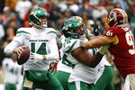 New York Jets quarterback Sam Darnold (14) works in the pocket against the Washington Redskins in the first half of an NFL football game, Sunday, Nov. 17, 2019, in Landover, Md. (AP Photo/Patrick Semansky)