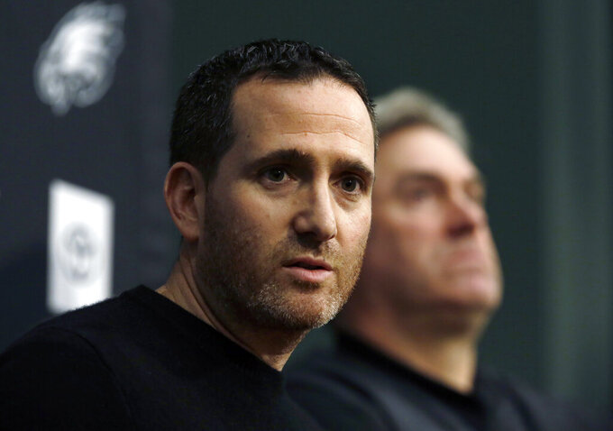 Howie Roseman, left, executive vice president of football operations for the Philadelphia Eagles NFL football team, answers a reporter's question alongside coach Doug Pederson during a news conference Tuesday Jan. 15, 2019, in Philadelphia. The Eagles lost to the New Orleans Saints on Sunday, ending their season. (AP Photo/Jacqueline Larma)