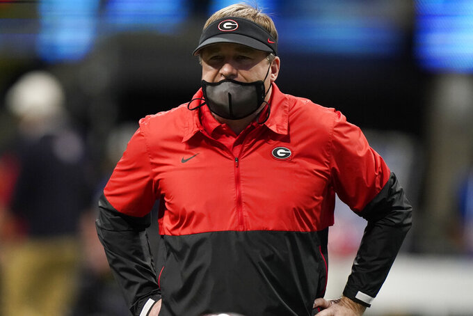 Georgia head coach Kirby Smart watches play against Cincinnati during the first half of the Peach Bowl NCAA college football game, Friday, Jan. 1, 2021, in Atlanta. (AP Photo/Brynn Anderson)