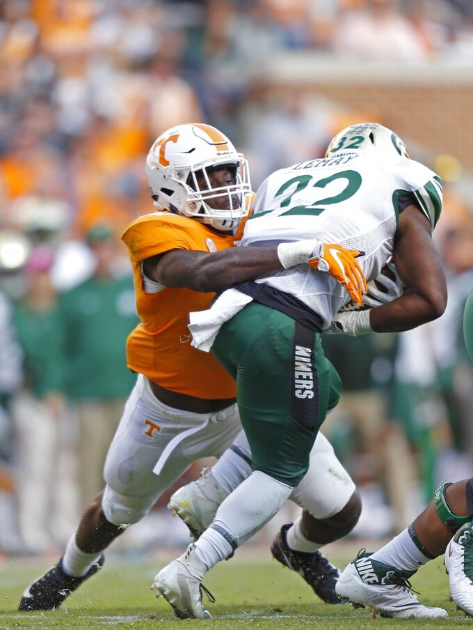 Tennessee linebacker Daniel Bituli (35) tackles Charlotte running back Benny LeMay (32) in the first half of an NCAA college football game Saturday, Nov. 3, 2018, in Knoxville, Tenn. (AP Photo/Wade Payne)