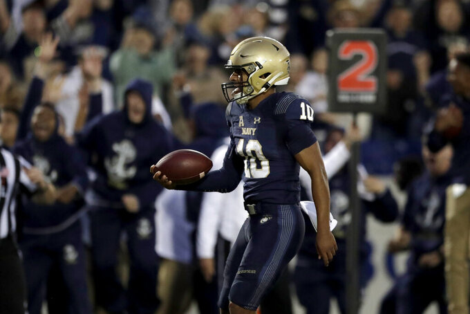 Navy quarterback Malcolm Perry reacts after scoring a touchdown during the second half of an NCAA college football game against Air Force Saturday, Oct. 5, 2019, in Annapolis, Md. Navy won 34-25. (AP Photo/Julio Cortez)