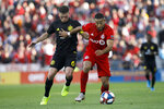Toronto FC defender Justin Morrow (2) and Columbus Crew SC midfielder Will Trapp (6) vie for the ball during the first half of an MLS soccer match in Toronto, Sunday, Oct. 6, 2019. (Cole Burston/The Canadian Press via AP)