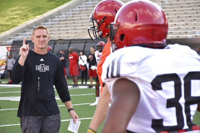 "FILE - In this Sept. 6, 2017, file photo, coach Blake Anderson talks players during practice at Centennial Bank Stadium in Jonesboro, Ark. Arkansas State doesn't have to look too hard for inspiration before facing what coach Blake Anderson calls ""the best team on the planet."" The Red Wolves face No. 1 Alabama Saturday, Sept. 8, 2018, a week after fellow Sun Belt Conference power Appalachian State pushed 13th-ranked Penn State into overtime.(Staci Vandagriff/The Jonesboro Sun via AP, File)"