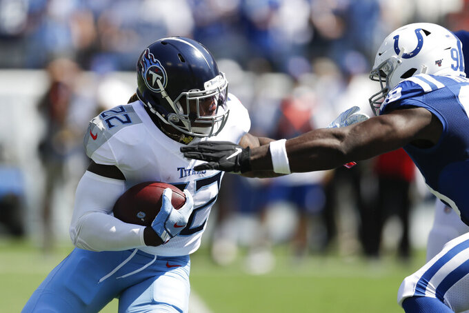 Tennessee Titans running back Derrick Henry (22) carries the ball against Indianapolis Colts defensive end Justin Houston (99) in the first half of an NFL football game Sunday, Sept. 15, 2019, in Nashville, Tenn. (AP Photo/James Kenney)