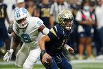 Georgia Tech quarterback Jordan Yates (13) is sacked by North Carolina defensive lineman Myles Murphy (8) during the first half of an NCAA college football game Saturday, Sept. 25, 2021, in Atlanta. (AP Photo/John Bazemore)