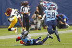 Pittsburgh Steelers wide receiver Ray-Ray McCloud (14) flies through the air after being hit by Tennessee Titans cornerback Malcolm Butler (21) in the second half of an NFL football game Sunday, Oct. 25, 2020, in Nashville, Tenn. (AP Photo/Wade Payne)