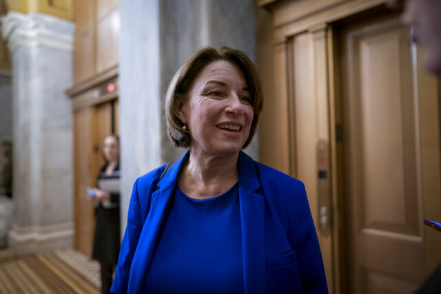 Democratic presidential candidate Sen. Amy Klobuchar, D-Minn., pauses before leaving the Capitol at the close of defense arguments by the Republicans in the impeachment trial of President Donald Trump on charges of abuse of power and obstruction of Congress, in Washington, Tuesday, Jan. 28, 2020. (AP Photo/J. Scott Applewhite)