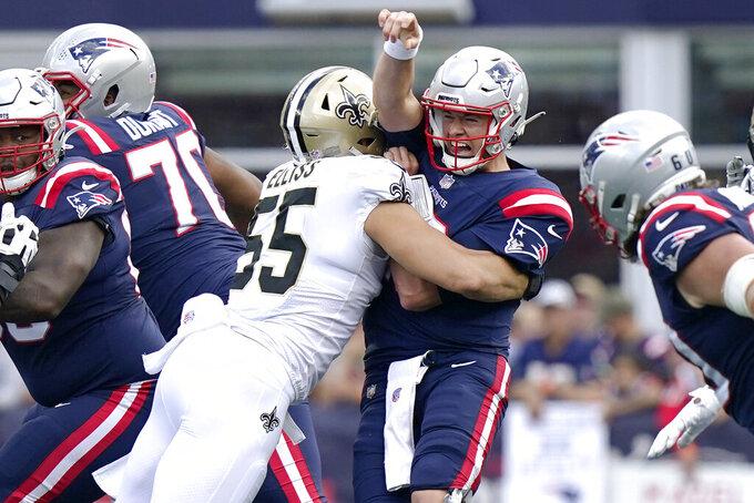 New England Patriots quarterback Mac Jones is taken down by New Orleans Saints linebacker Kaden Elliss (55) during the first half of an NFL football game, Sunday, Sept. 26, 2021, in Foxborough, Mass. (AP Photo/Steven Senne)
