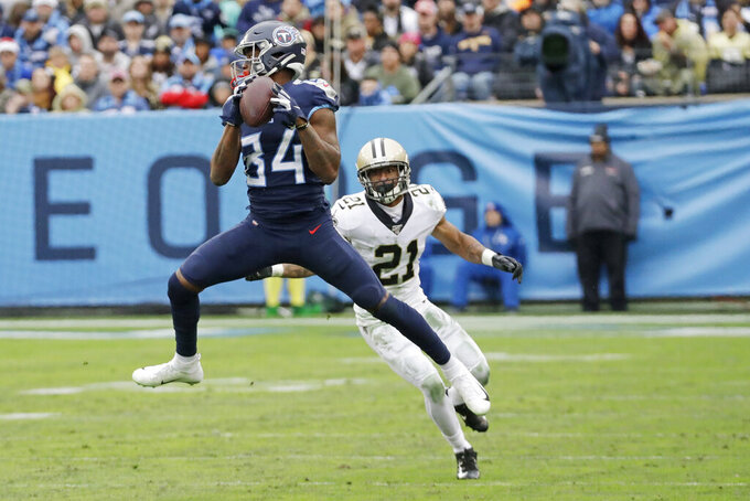 Tennessee Titans wide receiver Corey Davis (84) catches a pass in front of New Orleans Saints defensive back Patrick Robinson (21) in the second half of an NFL football game Sunday, Dec. 22, 2019, in Nashville, Tenn. (AP Photo/James Kenney)