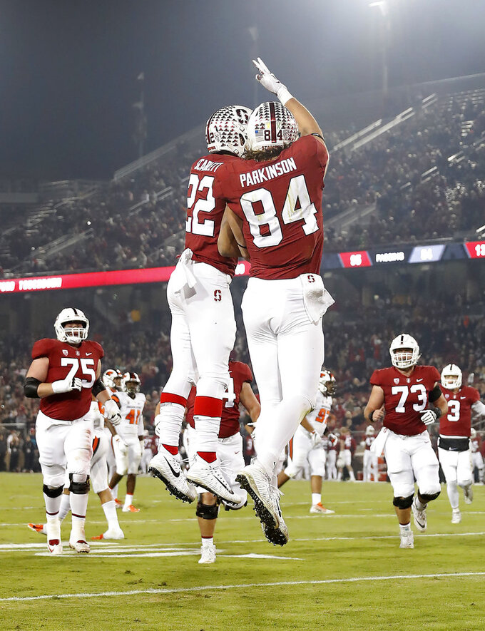 CORRECTS DATE - Stanford tight end Colby Parkinson (84) celebrates with teammate Cameron Scarlett (22) after scoring a touchdown against Oregon State in the first half during an NCAA college football game on Saturday, Nov. 10, 2018, in Stanford, Calif. (AP Photo/Tony Avelar)