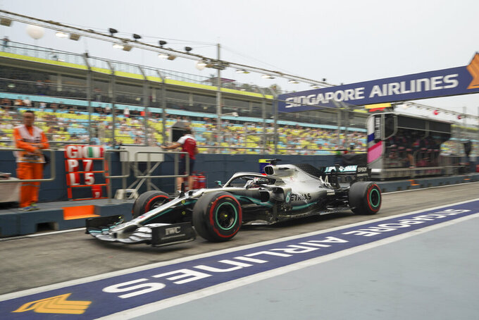 Mercedes driver Lewis Hamilton of Britain steers his car during the first practice session at the Marina Bay City Circuit ahead of the Singapore Formula One Grand Prix in Singapore, Friday, Sept. 20, 2019. (AP Photo/Vincent Thian)